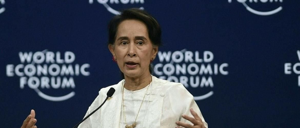 Suu Kyi defends arrest of journalist